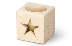 Carved limestone votive holder with star design.